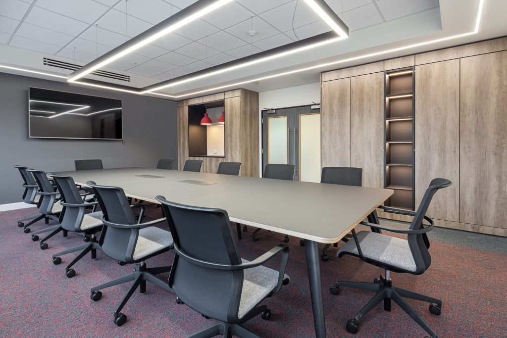 Spacious meeting room with long desk