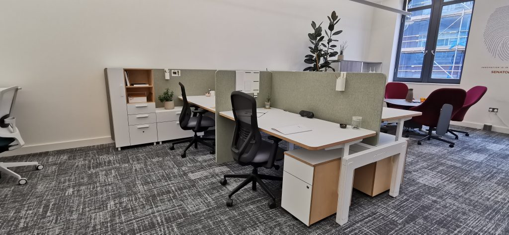 Spaced out office with separated work desks