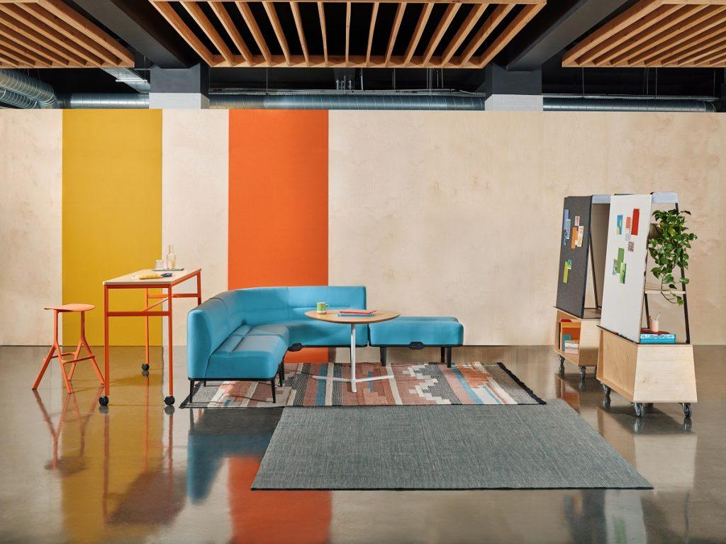Blue corner office sofa in drop-in office space