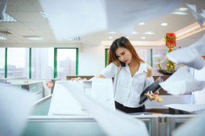 An office worker using a photocopier