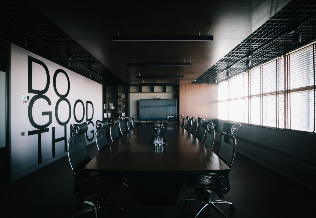 Hotel conference room with branded wall saying Do Good Things